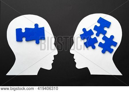 Papercut Head With Jigsaw Puzzle Pieces On Black Background
