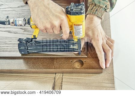 Skilled Carpenter Assembles Wooden Door Fixing Glazing Bead
