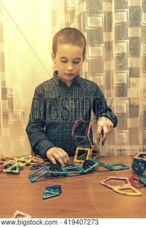 Boy Playing With Magnetic Constructor Toy. Cute Little Boy Playing With Colorful Magnetic Constructo