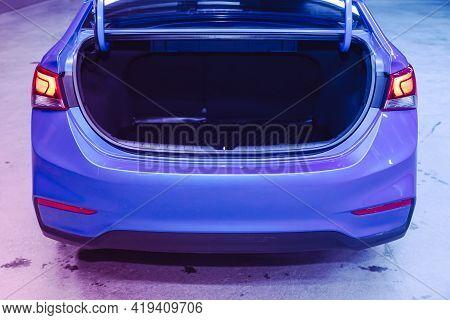 Novosibirsk, Russia - April 25 2021: Hyundai Solaris , Rear View Of A Car With An Open Trunk Under P