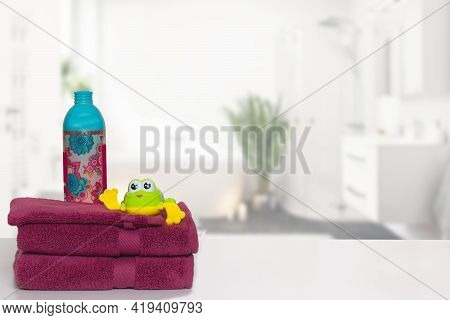 Table Top On Towels Background. Closeup Of A Stack Or Pile Of Violet Soft Terry Bath Towels With A W