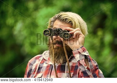 Observing Nature. Man Ornithology Expedition In Forest. Man Observing Nature. Hipster Tourist Holds