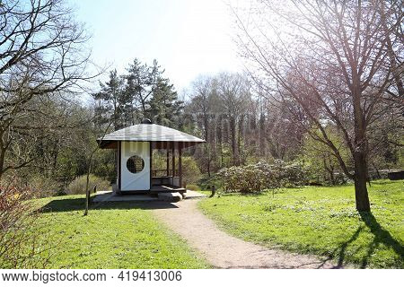 Traditional Gazebo In Japanese Garden At Sunny Day, Asian Culture. Wooden Tea House Built In Retro S
