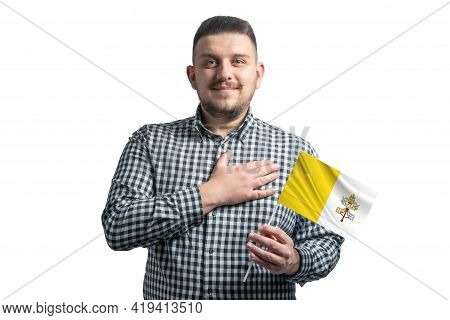 White Guy Holding A Flag Of Vatican And Holds His Hand On His Heart Isolated On A White Background W