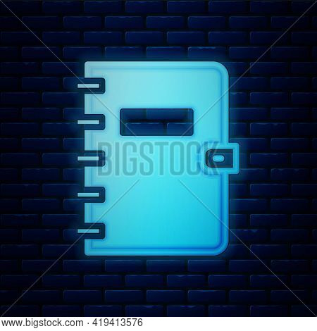 Glowing Neon Notebook Icon Isolated On Brick Wall Background. Spiral Notepad Icon. School Notebook.