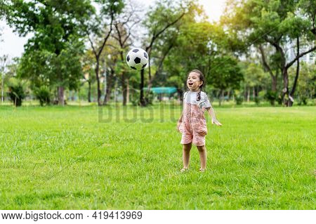 Sports Kid. Happy Little Girl Kid Kicking A Soccer Ball, Child Plays