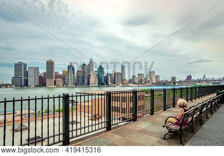 New York City, Ny / Usa - July 16 2014: An Unidentified Lonely Woman Gazes At Lower Manhattan Skylin