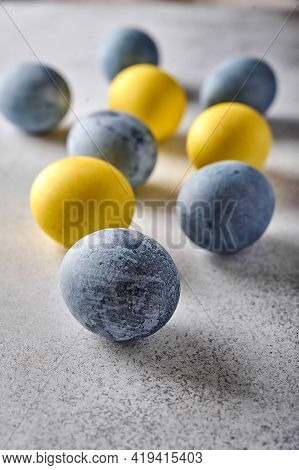 Vertical Orientation Homemade Easter Colored Yellow And Grey Marble Eggs. Close Up, Selective Focus