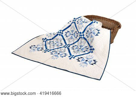 Patchwork White-blue Quilt On A White Background. Patchwork Blanket. Handmade. Patchwork Quilt On A