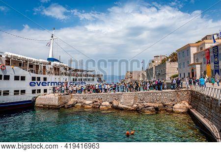 Hydra, Greece - April 29 2018: People Embark On The Cruising Boat.