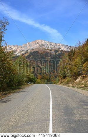 Sunny Autumn Day Over Road With Blue Sky On Caucasus Mountains In Adygea, Russia