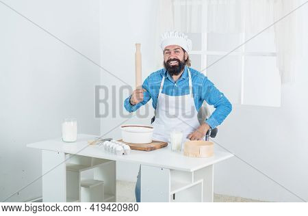 Handsome Man With Beard And Moustache Cooking Food. Professional Restaurant Cook Baking. Skilled Bak