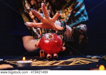 Astrology. A Witch Conjures An Apple. Close-up. The Concept Of Divination, Magic And Esotericism.