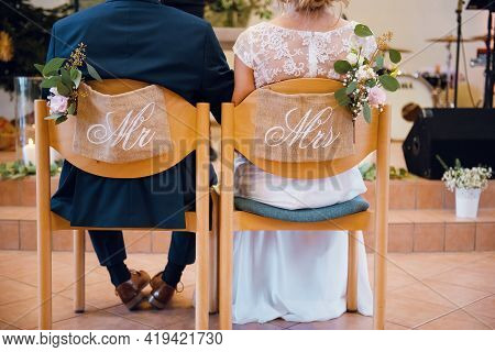 Mr. And Mrs. Seating At The Chairs