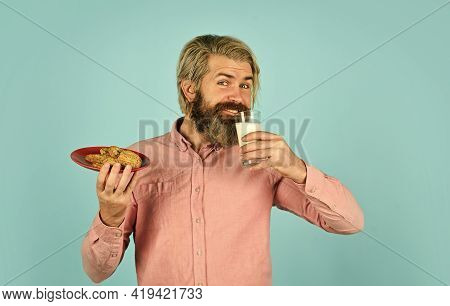 Homemade Is Best. Recipe For Baking Cookies. Taste Of Childhood. Bearded Man Drink Milk With Cookies