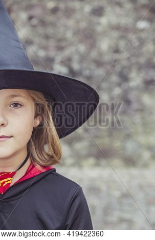 Young Fair-haired Sorceress In Mantle And Hat
