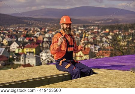 Estimate Materials Requirements For Projects. Install Roofing Materials. Heat Insulation. Man Roofin