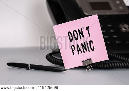 The Text Dont Panic Written On A Pink Sticky Note To Remind You An Important Event. Closeup Of A Per