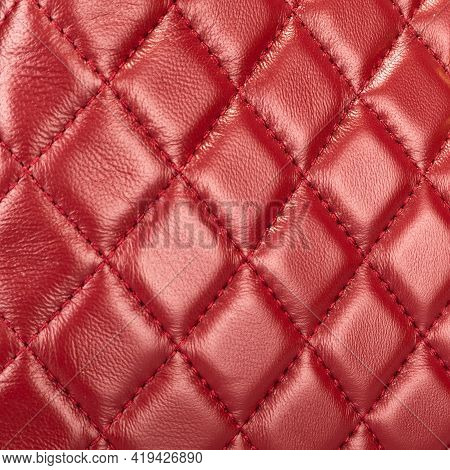 Red Leather Background And Texture, Stitched With Diamond-shaped Threads, As A Pattern For The Inter