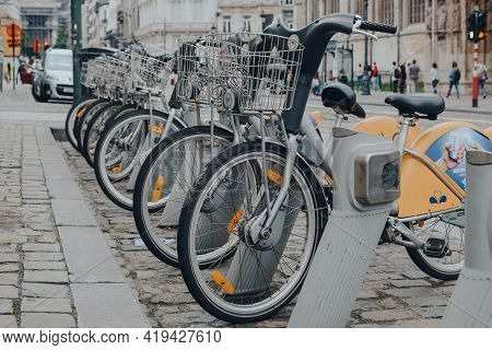 Brussels, Belgium - August 16, 2019: Row Of Villo Bikes, A Public Bicycle Rental Programme, On A Str