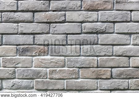 White Brick Wall Background In Rural Room. Abstract Weathered Texture Stained Old Stucco Light Gray.