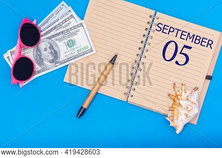 5th Day Of September. Travel Concept Flat Lay - Notepad With The Date Of 5 September Pen, Glasses, D