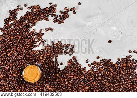 Cup Of Strong Coffee With Aromatic Foam And Roasted Coffee Beans Arranged In A Wave Shape, Mock-up O