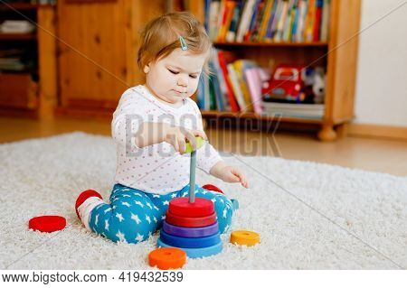 Adorable Cute Beautiful Little Baby Girl Playing With Educational Wooden Toys At Home Or Nursery. To