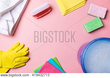 House Cleaning Product And Bucket, Pail, Container With Foam On Pink Background, Copy Space. Flat La