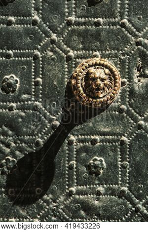 Beautiful And Vintage Door Handle Lion Shaped On Green Metal Door With Trim Ornaments And Balusters