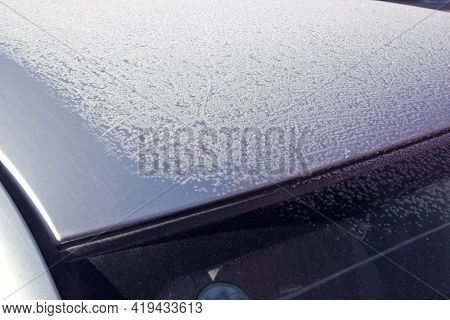 Partially Covered With Frost Car Roof And Windscreen. Winter Pattern At Sun