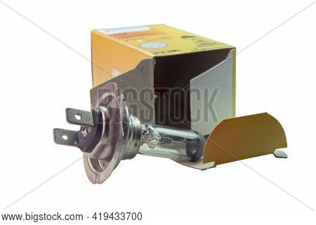 Dual-contact Halogen Spare Lamp For Low Beam Car Headlights, Out From Its Cardboard Packaging. Isola