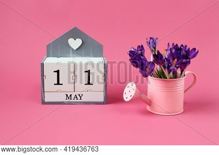 Calendar For May 11: A Cube With The Number 11, The Name Of The Month Of May In English,a Pink Water