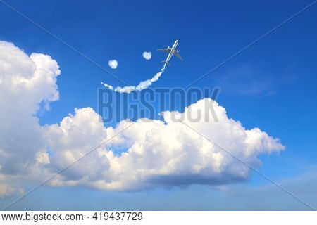 Aircraft draw a smiling face in the sky. Flight route of aircraft in shape of a face. Happy concept for traveling the world