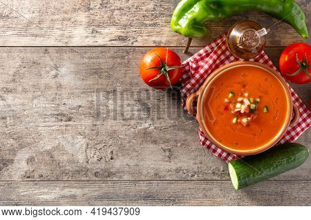 Gazpacho Soup In Crock Pot And Ingredient On Wooden Table. Top View. Copy Space