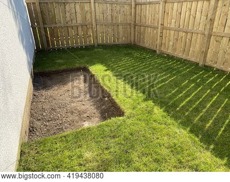 House Garden Grass Turf Cut For Ground Preparation To Allow Stone Sub Base To Be Laid