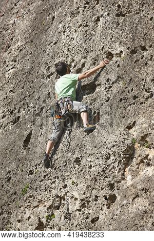 Climber On A Granite Wall. Extreme Sport. Outdoor Mountain Activity
