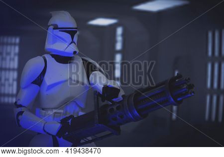 MAY 1 2021: Scene from Star Wars The Clone Wars - Clone trooper Heavy with blaster defending Rishi Moon station - Hasbro action figure