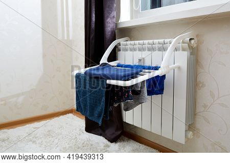 Clothes Dryer. Blue Clothes Is Fixed To Dry After Washing At Home On Battery. Idea For Saving Space,