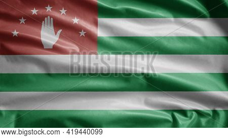 Abkhazian Flag Waving In The Wind. Close Up Of Abkhazia Banner Blowing, Soft And Smooth Silk. Cloth