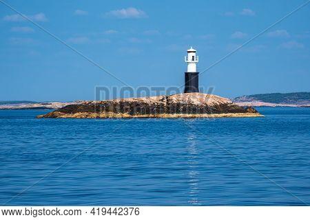 Lighthouse In The Archipelago Near Fjaellbacka In Sweden.