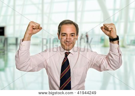 successful business man with open arms at the office