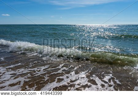 Sea Waves In The Sunlight. Sea Coast. Waves And Storms At Sea. Waves On The Baltic Sea.