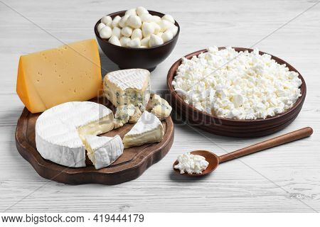 Clay Dishware With Fresh Dairy Products On White Wooden Table