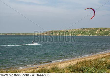 Man Kite Surfing (kite-boarding) In The Salt Lake (tuz Golu) Near Kefalos Beach In Gokceada Island (