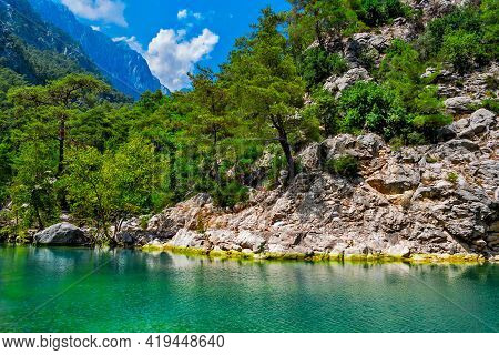 Blue Lake In The Mountains On A Sunny Summer Day