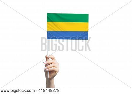 Beautiful Female Hand Holding Gabon Flag, Isolated On White Background.
