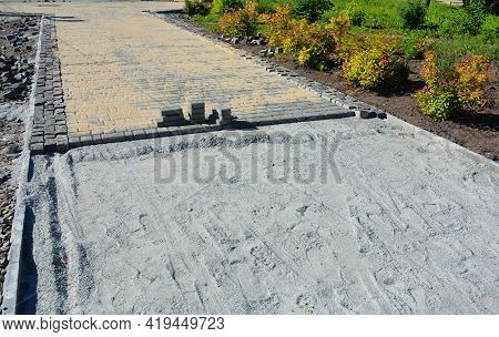 Paver Walkway, Pathway Installation And Building: A Close-up Of Concrete Pavers Installation And Joi