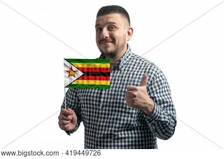 White Guy Holding A Flag Of Zimbabwe And Shows The Class By Hand Isolated On A White Background. Lik