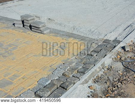 A Close-up Of A Block Footpath Paving, Paver Edging And Pavers Installation, Building A Paver Walkwa